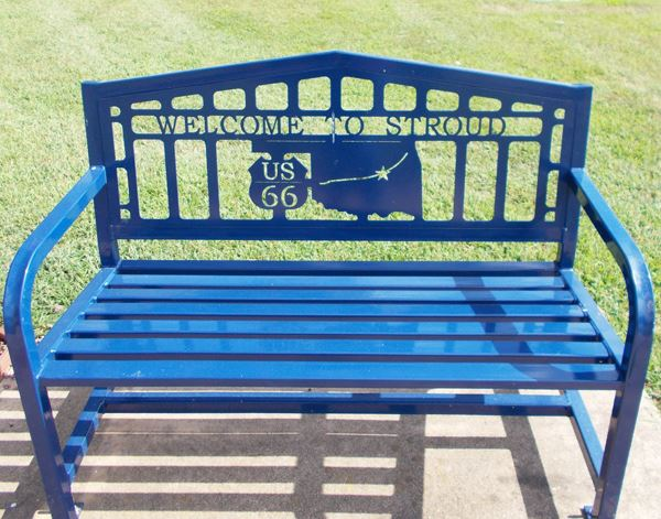 "Park bench with ""Welcome to Stroud"" and map of Route 66 through Oklahoma"